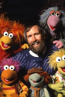 Jim Henson with puppets from Fraggle Rock.