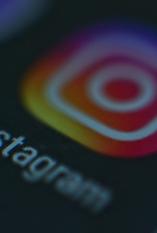 A photo of a monitor or a tablet or phone screen with the Instagram icon.