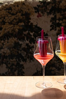 Pinky's Ice Pops — a glass of wine glass with a liquor-infused ice popsicle sticking out of it.