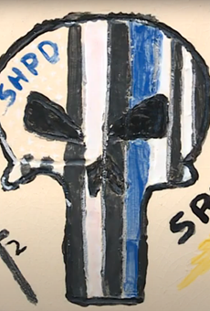 A tile featuring the controversial 'Punisher' logo, which has become co-opted by white supremacy and hate groups.