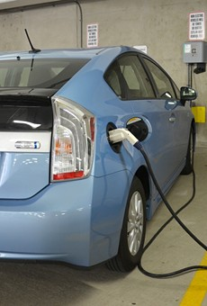 A car being charged at one of the 18 electric vehicle chargers in Ann Arbor.