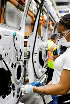 A woman working at Ford's Dearborn truck plant.