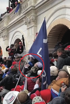 Trevor Brown is circled in red near the front of a violent crowd that was trying to push past police officers at a tunnel at the U.S. Capitol.