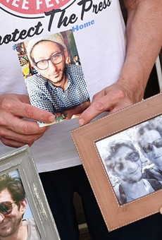 Journalist Danny Fenster's family holds photographs of him at their Huntington Woods home.