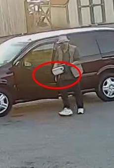 John Douglas Allen is shown carrying a box containing a bomb, FBI says.