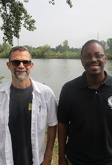 Paul Draus and Brian Yopp stand where they hope to see a park along the Rouge River.