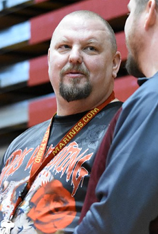 Female wrestling coach, promoter, and advocate Brent Harvey, center, has died.