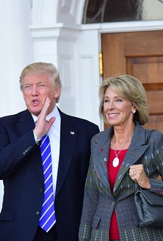 Then President-elect Donald Trump meets with Betsy DeVos at Trump International in Bedminister, New Jersey on Nov. 19, 2016.