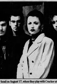 The Cranberries with O'Riordan (second from right) in a promotional poster for their August 17, 1996 concert at Pine Knob Music Theater.