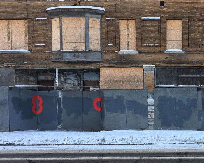 """Detroit artist Nick Jaskey's """"Red Circles"""" dot Detroit's derelict buildings. - COURTESY PHOTO"""