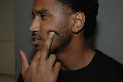Trey Songz flicks off the camera as he's booked in jail for allegedly assaulting a Detroit police officer in 2016. - MIKE MORSE LAW FIRM