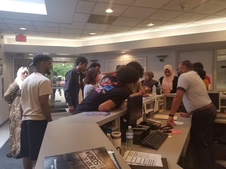 Universal Academy students ask for transcripts at a meeting last Wednesday, but were not given a clear answer, they said. When they returned two days later, the doors were locked. - AMERICA YAHYA