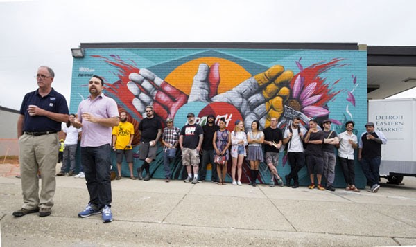 Eastern Market Director Dan Carmody, left, and 1xRUN co-founder Jesse Cory announce the artists for the Murals In The Market festival on Tuesday. - COURTESY PHOTO