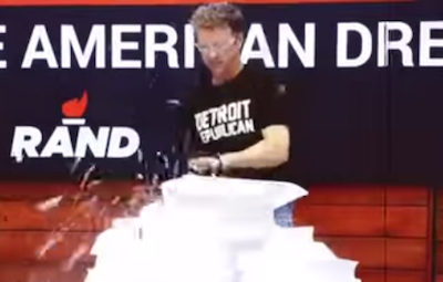 Rand Paul used a chainsaw, a wood chipper, and fire to destroy a 70,000-page copy of the tax code. But the only unusual thing one commentator found worth discussing was this T-shirt. - YOUTUBE