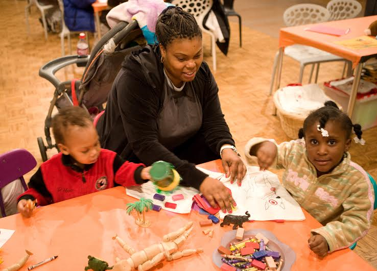 Visitors enjoy a drop-in workshop at the DIA. - PHOTO COURTESY OF THE DETROIT INSTITUTE OF ARTS.