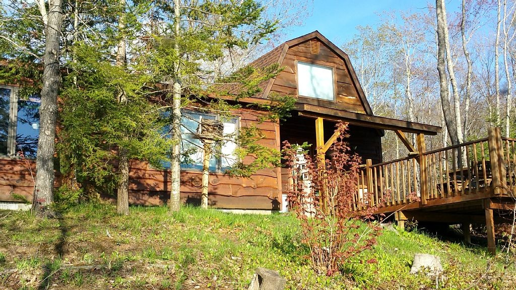 cabin park surrounded bay cabins lake secluded on beachfront michigan vrbo cathead in state rentals by