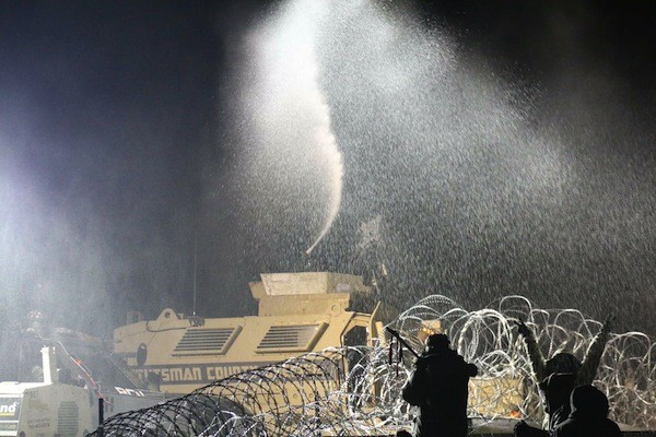 Among the arsenal of weapons deployed against protestors: water cannons in freezing weather. - PHOTO COURTESY SAM WALDMAN