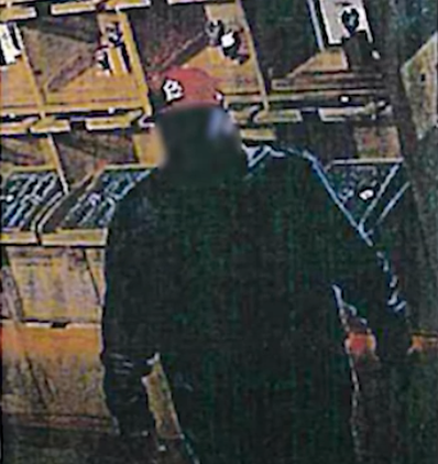 Blurry surveillance image of the suspect. - ACLU