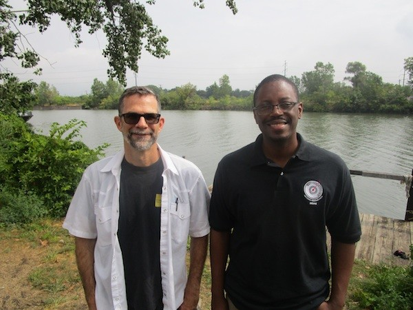 Paul Draus and Brian Yopp stand where they hope to see a park along the Rouge River. - PHOTO BY MICHAEL JACKMAN
