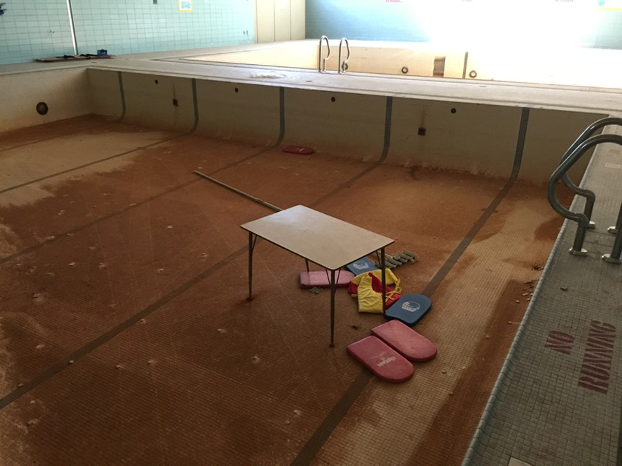 In this photo from the lawsuit, any water in the disused pools at Osborn High School is there only by accident. - PHOTO COURTESY PUBLIC COUNSEL