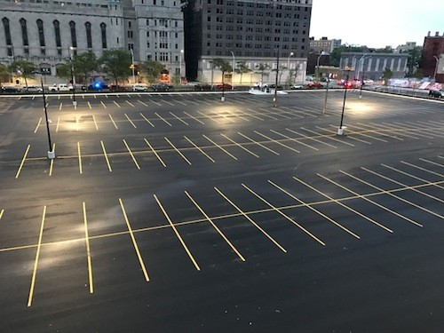 While she struggles to find a spot to park, a commodious and often empty lot sits outside Huston's apartment window. - PHOTO COURTESY KRISTEN HUSTON