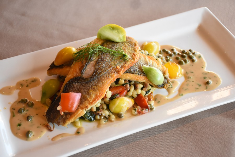 Assaggi's bronzino can feature playful touches, such as the way the capers in this dish mimic the shape of the fregola sarda. - RACHEL TIMLIN