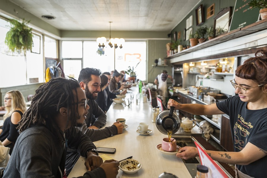 A diverse group of diners meet at Rose's Fine Food in Detroit. - JACOB LEWKOW