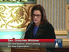 "Whitmer speaking at the Michigan Senate chamber while advocating against a ""rape insurance."""