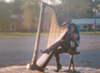 Harpist and singer-songwriter Ahya Simone in a still from <i>Showing Up Showing Out</i>, a film by Margot Bowman & Imani Mixon about the past, present, and future of Motown.