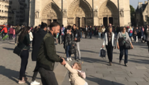 Michigan woman seeking man and girl in viral Notre Dame photo