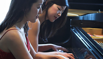 It takes two — the Mack Sisters head to DIA with four-handed piano performance