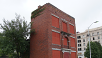 The Cole building frozen out of Cass Park historic district
