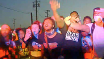 Detroit police release videos of squad car driving through crowd of protesters