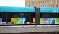 The QLine sports a nifty wrap before it debuts May 12