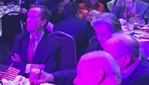 Here's a photo of Bill Schuette cozying up to Steve Bannon