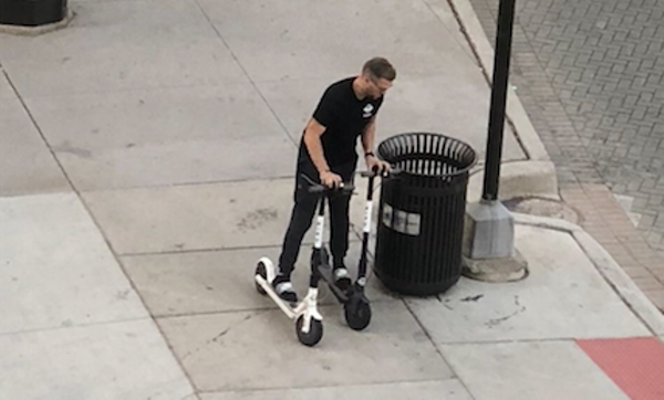 What scooter-hogging wizardry is this? Man seen riding two