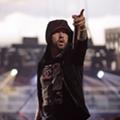 Eminem's manager fires back after rapper blasted for using gunshot sound effects