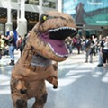 MCC banned a student from speaking publicly while wearing a T-Rex costume, now he's suing