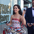 A woman wore a dress made out of 'Metro Times' to the 'Detroit' movie premiere