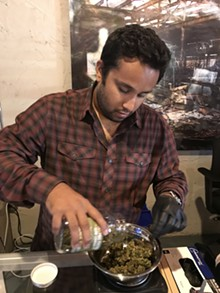 LARRY GABRIEL - Rush Hasan shows Tahoe Kush, a strain of cannabis that is low on THC but high on CBD, at The Reef provisioning center in Detroit.