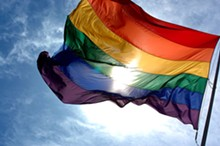 640px-rainbow_flag_and_blue_skies.jpg