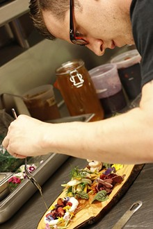 SCOTT SPELLMAN - James Rigato prepares an all-Michigan dish at the Root in White Lake Township.