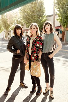 PHOTO BY BRIGITTE SIRE - From left: Sleater-Kinney are Janet Weiss, Corin Tucker, and Carrie Brownstein.
