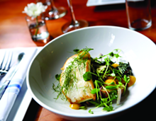 PHOTO BY ROB WIDDIS - Alaskan Halibut with summer greens, potato, nectarine chutney, warm bacon vinaigrette, and crispy fennel, from Chartreuse in Detroit.