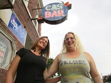 PHOTO BY MICHAEL JACKMAN. - Cas Bar regular Stacie Goolsby and bartender Jodie Welbes pose underneath the bar's weathered sign.