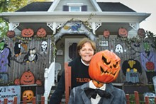 "PHOTOS BY VAUGHN GURGANIAN. - Vicki Lee, the ""good witch"" who started a tradition of - Halloween decoration on - Tillson Street in Romeo."