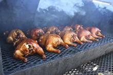PHOTO BY SCOTT SPELLMAN. - Chicken on the smoker at Satchel's BBQ.