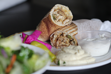 PHOTO BY SARAH RAHAL. - Chicken shawarma sandwich and pickles.