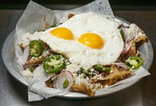PHOTO BY TOM PERKINS. - Chilaquiles.