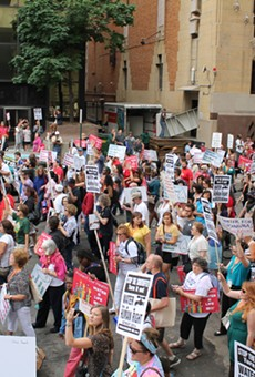 More than 1,000 people demonstrated in the streets of downtown Detroit against the city's ongoing water shutoffs on July 18, 2014. The protest was organized by the National Nurses United.